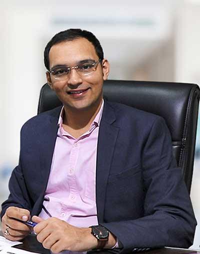 Dr. Puneet Dhawan